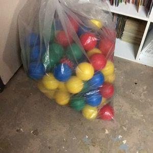 A bag of 3 inch light plastic balls